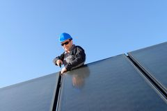 Man installing alternative energy photovoltaic pan Royalty Free Stock Images