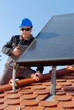 Man installing alternative energy photovoltaic sol Royalty Free Stock Photos
