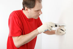Man installing angle bracket royalty free stock photography