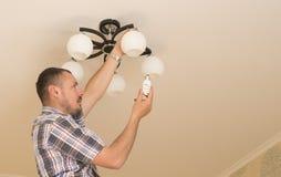 Man installing  bulb Royalty Free Stock Image
