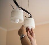 Man installing  bulb Stock Photos