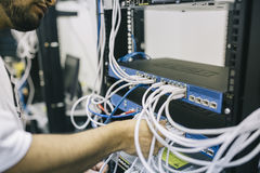 Man installing cables in server rack