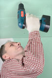 Man installing drywall Royalty Free Stock Images