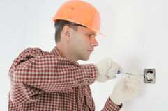 Man installing electrical box Royalty Free Stock Images