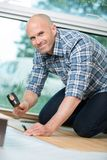 Man installing the flooring royalty free stock image
