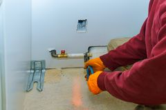 Man installing appliance gas hob in a kitchen. Man installing a gas appliance hob in a kitchen stock images