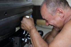 Man installing hitch car Stock Photo
