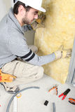 Man installing insulation royalty free stock photos