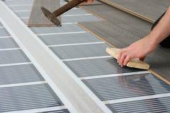 Man installing laminate floor stock photos