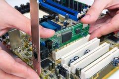 Man installing LAN network adapter Royalty Free Stock Photography