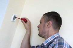 Man installing light switch Royalty Free Stock Image
