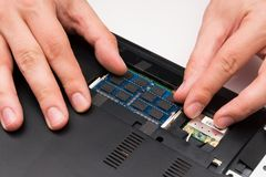 Man installing memory in computer Royalty Free Stock Photo