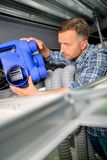 Man installing new air conditioning unit Stock Images