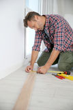 Man installing new wooden floor Royalty Free Stock Image