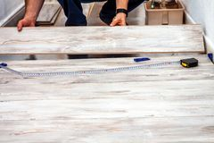 Man installing new wooden laminate flooring at home. Man installing new wooden laminate flooring at home stock images