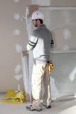 Man installing plaster divide. Man installing plaster board divide Stock Images
