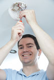 Man Installing Smoke Or Carbon Monoxide Detector Stock Photography