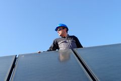 Man installing solar energy photovoltaic panels Royalty Free Stock Photography