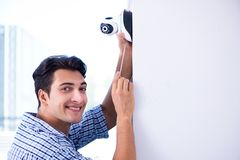 The man installing surveillance cctv cameras at home Stock Images