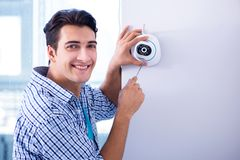 The man installing surveillance cctv cameras at home Stock Photography