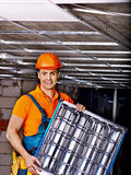 Man installing suspended ceiling Royalty Free Stock Images