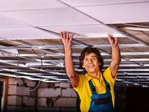 Man installing suspended ceiling Stock Images