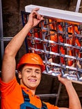 Man installing suspended ceiling Royalty Free Stock Photos