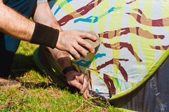 Man installing a tent Royalty Free Stock Image
