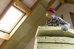 Free Man Installing Thermal Roof Insulation Layer - Using Mineral Woo Royalty Free Stock Images - 103791199