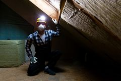 Man installing thermal roof insulation layer - using mineral woo stock photography