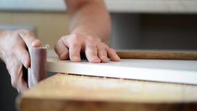 Man installing wood stock video footage