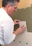Man installs ceramic tile. In bathroom shower Royalty Free Stock Photo