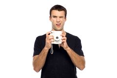 Man with instant camera Royalty Free Stock Photo
