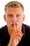 Man instructing you to keep silent Stock Photos