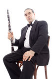 Man and instrument. A man playing his wind instrument with expression Royalty Free Stock Photo
