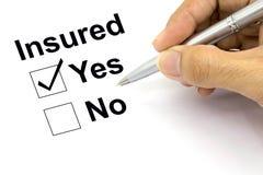 Man Insured yes check-box. Closeup Royalty Free Stock Images