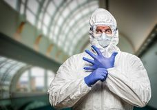 Man With Intense Expression Wearing HAZMAT Protective Suit Stock Image