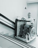 Man in an invalid chair Stock Photography