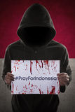 Man invite to pray for Indonesia Stock Photos