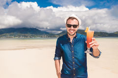 Man invites you to a cold drink on the beach Royalty Free Stock Photos