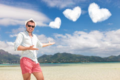 Man invites you to spend your honeymoon on the beach Stock Photography