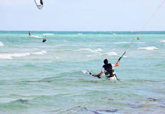 Man involved in kiteboarding Stock Image