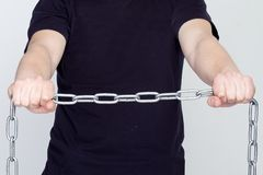 Man and iron chains. The concept of freedom and slavery.  royalty free stock images