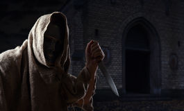 Man in iron mask with knife Royalty Free Stock Image