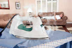 Man ironing Royalty Free Stock Images