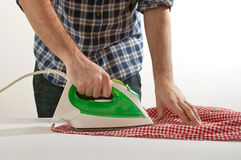 Man ironing Stock Photos