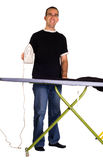 Man Ironing. Full body view of a man ironing his pants, isolated against a white background Royalty Free Stock Photos