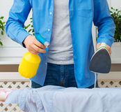 Man ironing clothes. Royalty Free Stock Photography