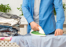 Man ironing clothes. Stock Photo