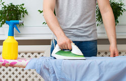 Man ironing clothes. Royalty Free Stock Images